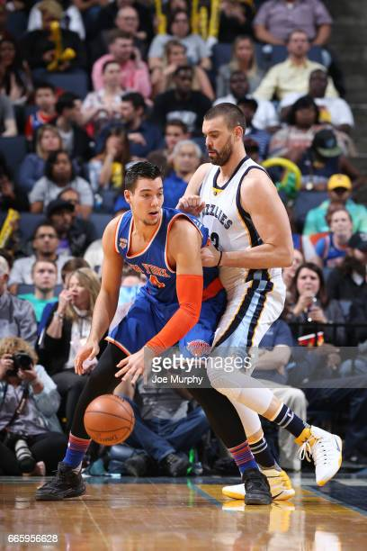 Willy Hernangomez of the New York Knicks handles the ball against Marc Gasol of the Memphis Grizzlies during a game on April 7 2017 at FedExForum in...