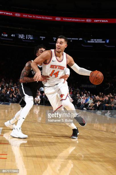 Willy Hernangomez of the New York Knicks handles the ball against the Brooklyn Nets during the preseason game on October 3 2017 at Madison Square...