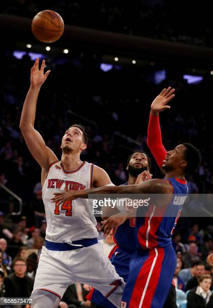 Willy Hernangomez of the New York Knicks heads for the net as Kentavious CaldwellPope and Andre Drummond of the Detroit Pistons defend at Madison...
