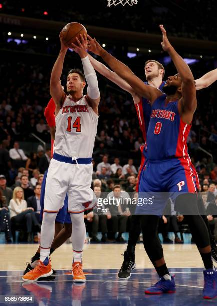 Willy Hernangomez of the New York Knicks heads for the net Kentavious CaldwellPope and Jon Leuer of the Detroit Pistons defend at Madison Square...