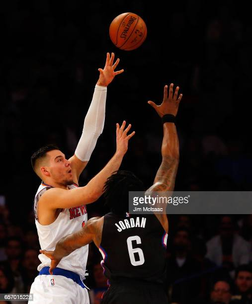 Willy Hernangomez of the New York Knicks in action against DeAndre Jordan of the Los Angeles Clippers at Madison Square Garden on February 8 2017 in...