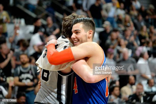 Willy Hernangomez of the New York Knicks shares a hug with Pau Gasol of the San Antonio Spurs after the game on March 25 2017 at the ATT Center in...
