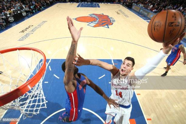 Willy Hernangomez of the New York Knicks shoots the ball during a game against the Detroit Pistons on March 27 2017 at Madison Square Garden in New...