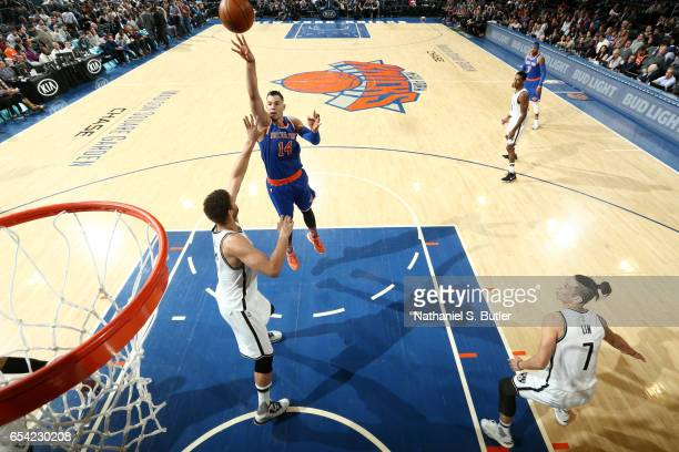 Willy Hernangomez of the New York Knicks shoots the ball during the game against the Brooklyn Nets on March 16 2017 at Madison Square Garden in New...