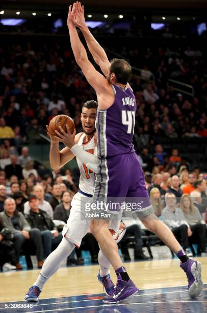 Willy Hernangomez of the New York Knicks works the ball against Kosta Koufos of the Sacramento Kings in the second half during their game at Madison...