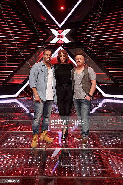 Willy Hubbard Sarah Conner and Bjoern Paulsen attend the 'XFactor' First Live Show on November 4 2012 in Cologne Germany