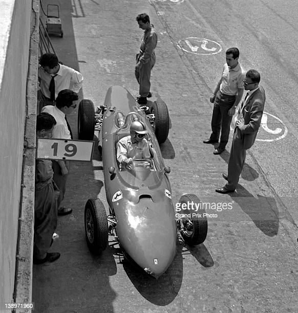 Willy Mairesse of Belgium sits aboard the Scuderia Ferrari Ferrari 156 Sharknose as Technical Director Mauro Forghieri oversees a test session on...