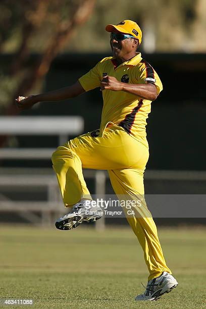 Willy Nona celebrates taking a catch in the final during the 20415 Imparja Cup on February 14 2015 in Alice Springs Australia