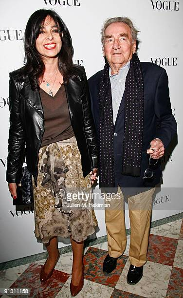 Willy Rizzo and a friend attend the 90 years of Vogue covers at Hotel Crillon on October 1 2009 in Paris France