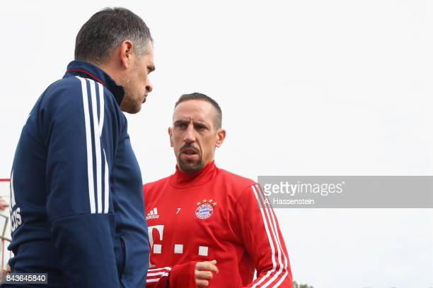 Willy Sagnol assistent coach of FC Bayern Muenchen talks to his player Franck Ribery prior to a FC Bayern Muenchen training session at Saebener...