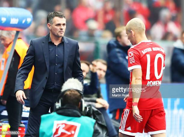 Willy Sagnol head coach of Bayern Munich substitutes Arjen Robben of Bayern Munich during the Bundesliga match between Hertha BSC and FC Bayern...