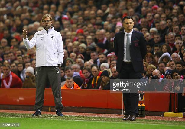 Willy Sagnol manager of Bordeaux looks on as Jurgen Klopp manager of Liverpool signals on during the UEFA Europa League Group B match between...