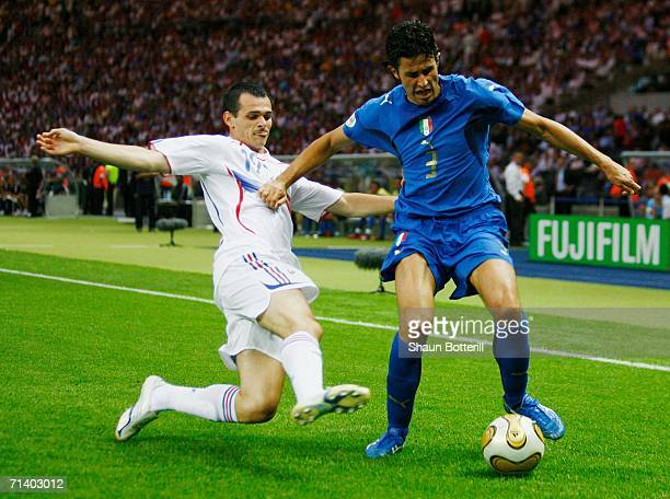 Willy Sagnol of France challenges Fabio Grosso of Italy for the ball during the FIFA World Cup Germany 2006 Final match between Italy and France at...