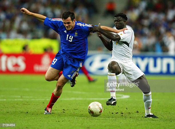 Willy Sagnol of France uses his strength to reach the ball ahead of Modeste Mbami of Cameroon during the FIFA Confederations Cup Final between France...