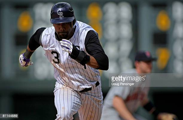 Willy Taveras of the Colorado Rockies steal third base against the Minnesota Twins in the eighth inning during Interleague MLB action at Coors Field...