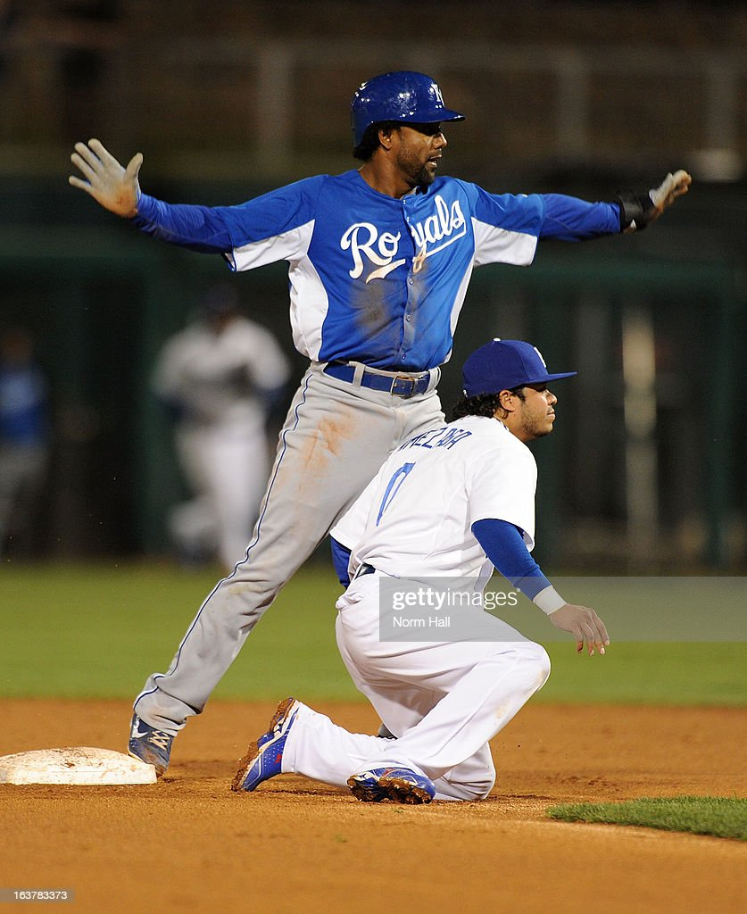 <a gi-track='captionPersonalityLinkClicked' href=/galleries/search?phrase=Willy+Taveras&family=editorial&specificpeople=223916 ng-click='$event.stopPropagation()'>Willy Taveras</a> #37 of the Kansas City Royals signals safe to the umpire as <a gi-track='captionPersonalityLinkClicked' href=/galleries/search?phrase=Alfredo+Amezaga&family=editorial&specificpeople=239472 ng-click='$event.stopPropagation()'>Alfredo Amezaga</a> #0 of the Los Angeles Dodgers waits for the call on March 15, 2013 in Glendale, Arizona.