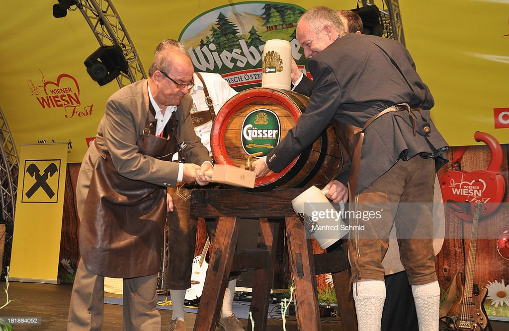 Willy Turecek (L) hammers a tap into the first keg of beer on stage during the 'Wiener Wirten Tag' as part of Wiener Wiesn Festival 2013 on September 25, 2013 in Vienna, Austria.