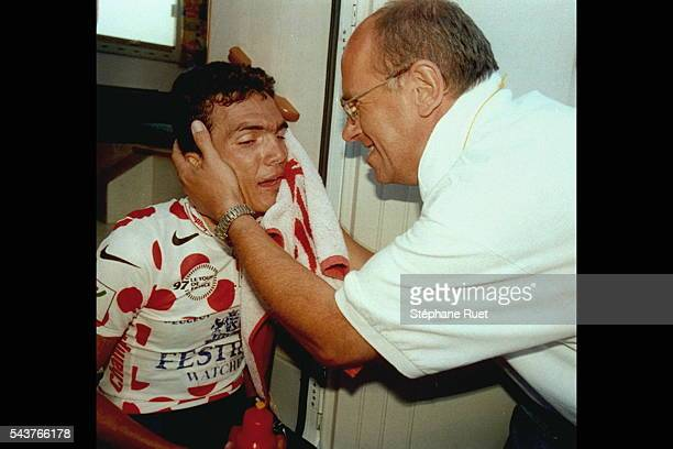 Willy Voet congratulates Richard Virenque after a lap of the Tour de France