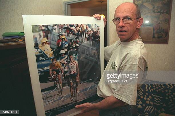 Willy Voet showing a photo signed by Richard Virenque during the 1997 Tour de France