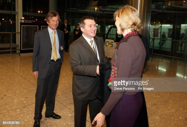 Willy Walsh from British Airways meets Clare Hammond who was the first passenger to leave the Plane from Hong Kong which was the first plane to land...