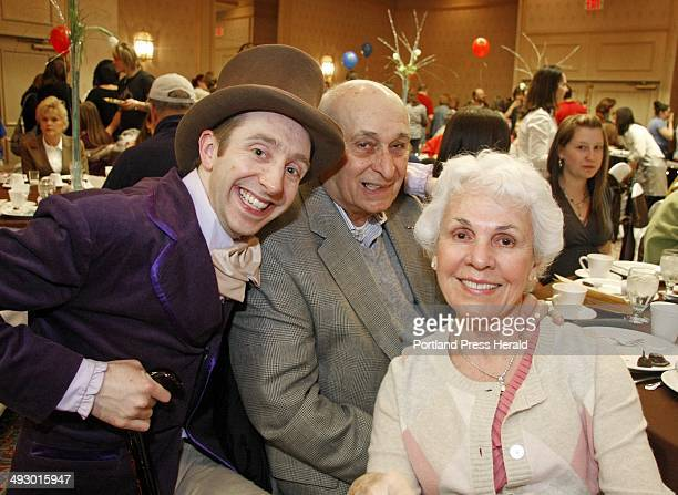Willy Wonka a k a Greg Caiazzo left stops for a photo with John and Jeanne Amato of Pembroke N H at the annual Chocolate Lover's Fling at the Holiday...