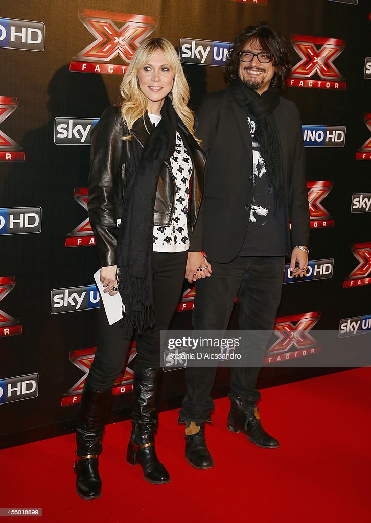 Wilma Oliviero (L) and Alessandro Borghese (R) attend 'X Factor 2013 - The Final' Red Carpet on December 12, 2013 in Milan, Italy.
