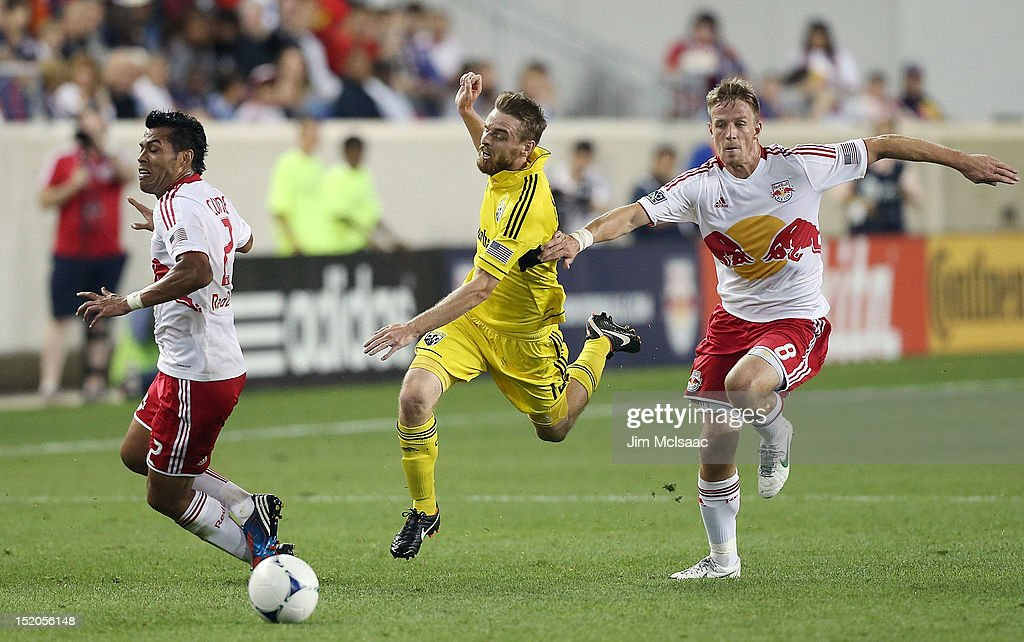 Wilman Conde and Jan Gunnar Solli of the New York Red Bulls defend against Eddie Gaven of the Columbus Crew at Red Bull Arena on September 15 2012 in...