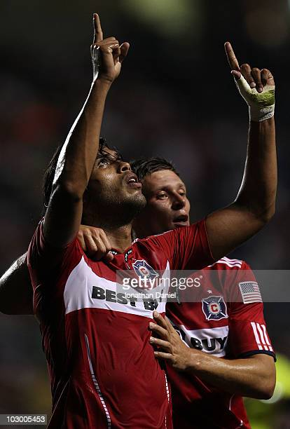 Wilman Conde of the Chicago Fire celebrates his first half goal with teammate Krzysztof Krol against Pumas UNAM during a SuperLiga 2010 match at...