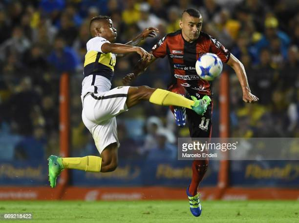 Wilmar Barrios of Boca Juniors fights for the ball with Fernando Telechea of Patronato during a match between Boca Juniors and Patronato as part of...
