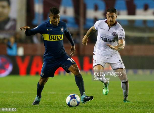 Wilmar Barrios of Boca Juniors fights for the ball with German Denis of Lanus during a match between Lanus and Boca Juniors as part of the Superliga...