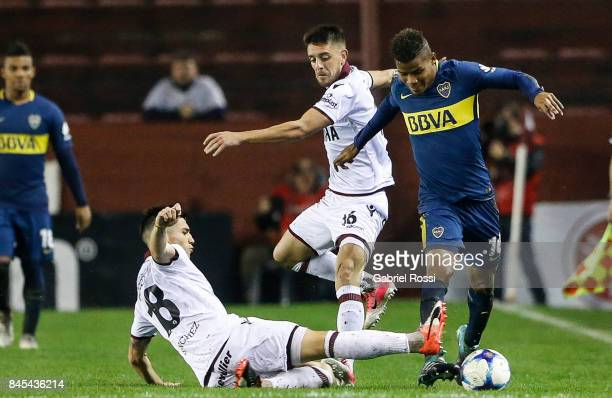 Wilmar Barrios of Boca Juniors fights for the ball with Matias Sanchez of Lanus during a match between Lanus and Boca Juniors as part of the...