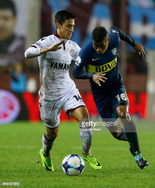 Wilmar Barrios of Boca Juniors fights for the ball with Matias Rojas of Lanus during a match between Lanus and Boca Juniors as part of the Superliga...
