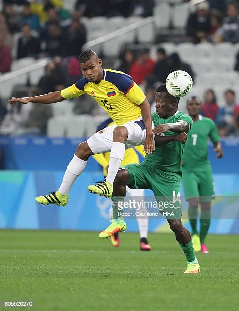 Wilmar Barrios of Colombia challenges Okechukwu Azubuike of Nigeria during the Men's First Round Group B match between Colombia and Nigeria on Day 5...