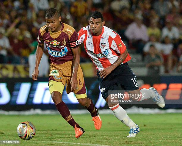 Wilmar Barrios of Tolima vies the ball with Luis Narvaez of Junior during a first leg match between Deportes Tolima and Ateltico Junior as part of...