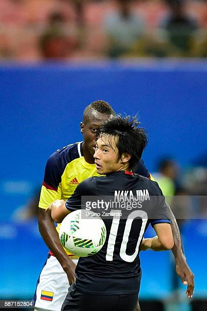 Wilmar Barrios player of Colombia competes for the ball with Shoya Nakajima player of Japan during 2016 Summer Olympics match between Japan and...
