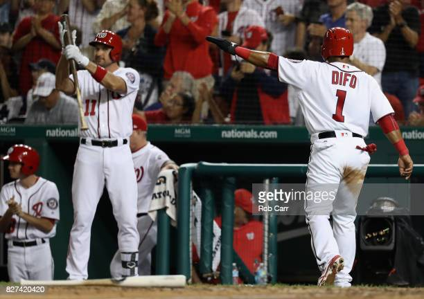 Wilmer Difo of the Washington Nationals and Ryan Zimmerman celebrate after Difo scored the go ahead run in the eighth inning to give the Nationals a...
