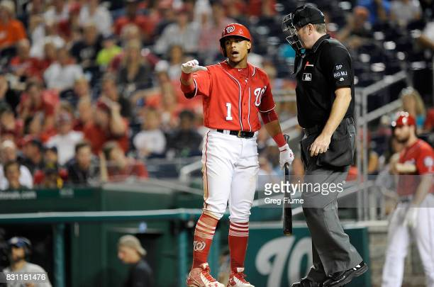 Wilmer Difo of the Washington Nationals argues with home plate umpire Chris Conroy after being called out on strikes in the 10th inning against the...