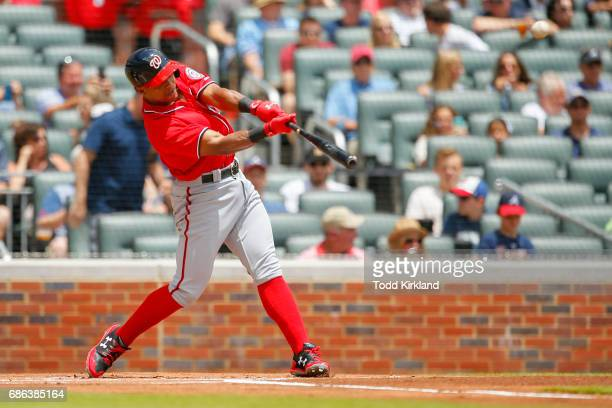 Wilmer Difo of the Washington Nationals hits a triple in the first inning of an MLB game against the Atlanta Braves at SunTrust Park on May 21 2017...