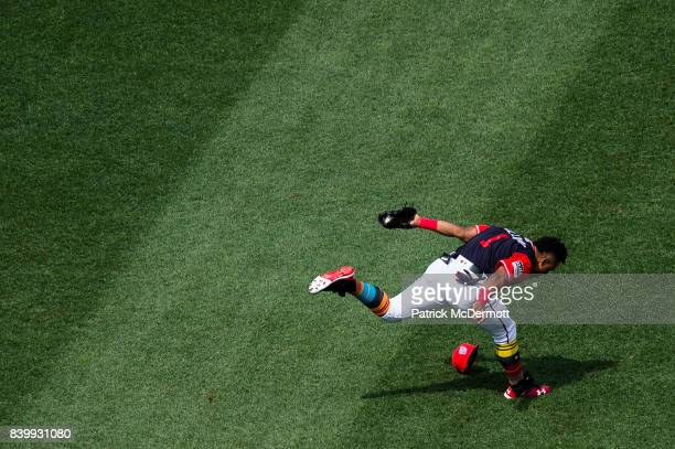 Wilmer Difo of the Washington Nationals is unable to make a play on an infield single hit by Juan Lagares of the New York Mets in the fifth inning...