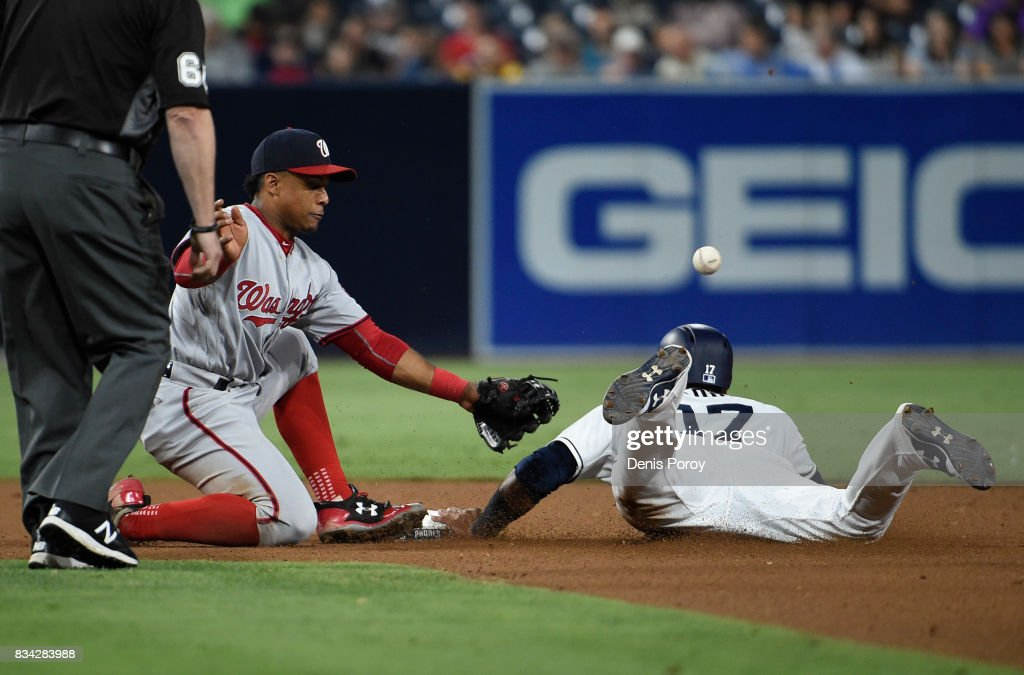 Wilmer Difo #1 of the Washington Nationals loses the ball as Allen Cordoba #17 of the San Diego Padres steals second base during the seventh inning of a baseball game at PETCO Park on August 17, 2017 in San Diego, California.