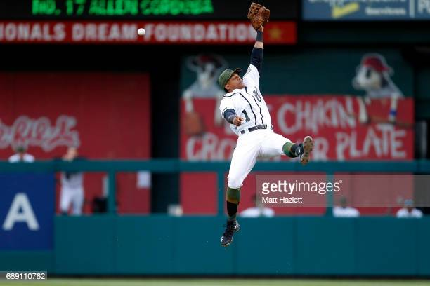Wilmer Difo of the Washington Nationals misses a catch off of a single hit by Allen Cordoba of the San Diego Padres during the first inning at...