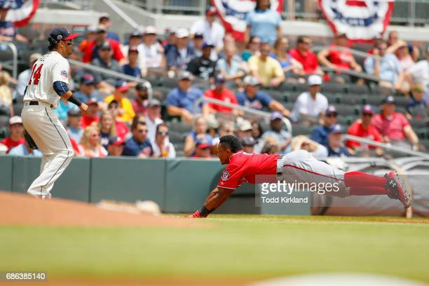 Wilmer Difo of the Washington Nationals slides into third for a triple in the first inning of an MLB game against the Atlanta Braves at SunTrust Park...
