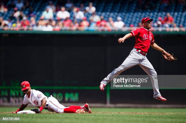 Wilmer Difo of the Washington Nationals steals second base against Andrelton Simmons of the Los Angeles Angels of Anaheim in the first inning during...