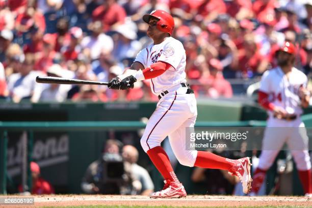 Wilmer Difo of the Washington Nationals takes a swing during game one of a doubleheader baseball game against the Colorado Rockies at Nationals Park...