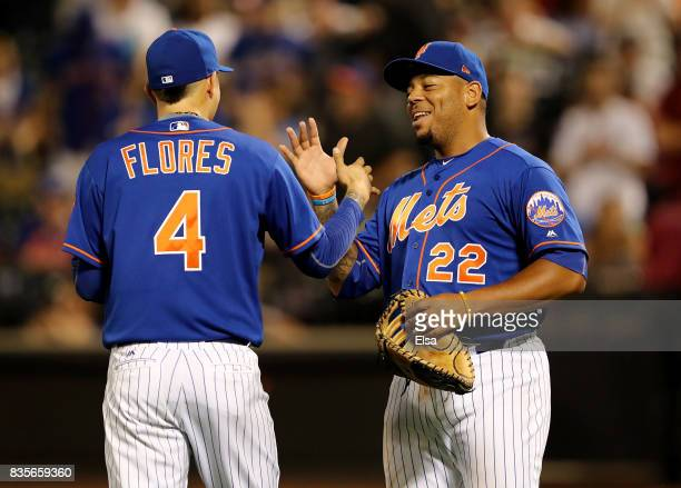 Wilmer Flores and Dominic Smith of the New York Mets celebrate the 81 win over the Miami Marlins on August 19 2017 at Citi Field in the Flushing...