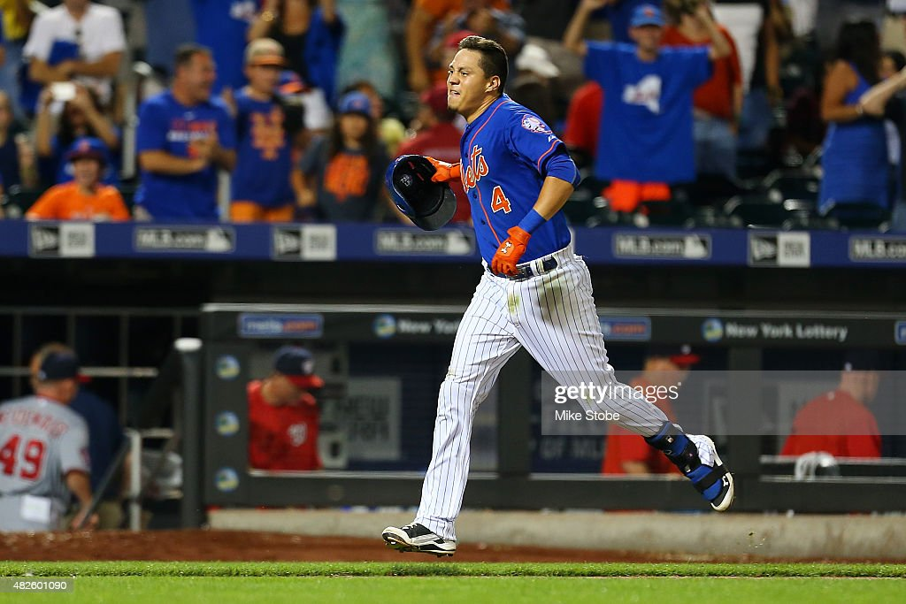Wilmer Flores of the New York Mets celebrates after hitting a twelfth inning walkoff home run against the Washington Nationals at Citi Field on July...