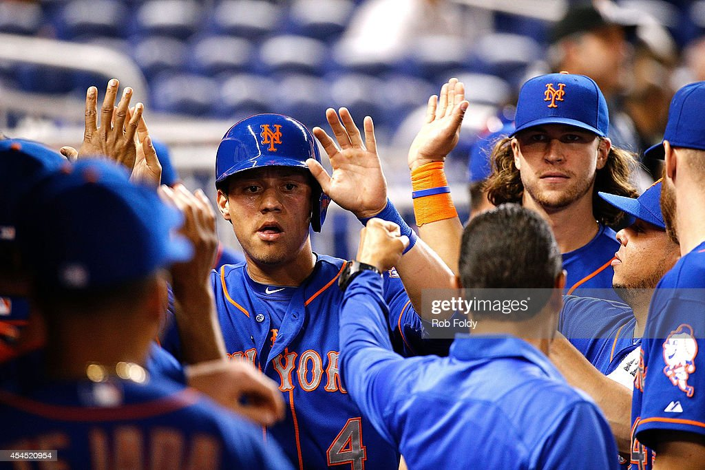 <a gi-track='captionPersonalityLinkClicked' href=/galleries/search?phrase=Wilmer+Flores&family=editorial&specificpeople=5970686 ng-click='$event.stopPropagation()'>Wilmer Flores</a> #4 of the New York Mets celebrates ith teammates after scoring during the second inning of the game against the Miami Marlins at Marlins Park on September 2, 2014 in Miami, Florida.