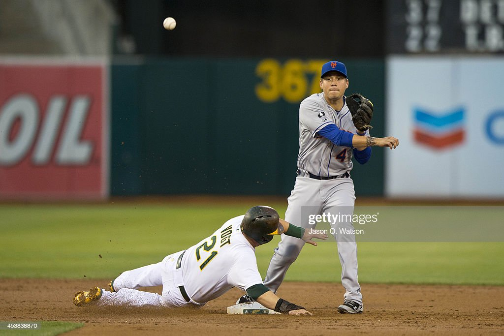 <a gi-track='captionPersonalityLinkClicked' href=/galleries/search?phrase=Wilmer+Flores&family=editorial&specificpeople=5970686 ng-click='$event.stopPropagation()'>Wilmer Flores</a> #4 of the New York Mets completes a double play over <a gi-track='captionPersonalityLinkClicked' href=/galleries/search?phrase=Stephen+Vogt&family=editorial&specificpeople=7511888 ng-click='$event.stopPropagation()'>Stephen Vogt</a> #21 of the Oakland Athletics during the second inning of an interleague game at O.co Coliseum on August 19, 2014 in Oakland, California.