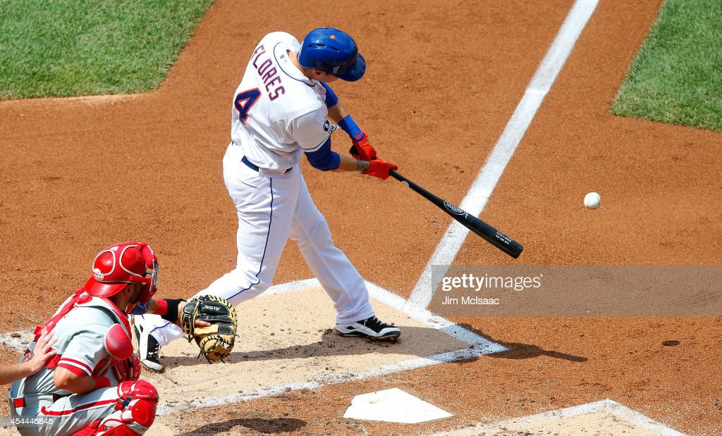 <a gi-track='captionPersonalityLinkClicked' href=/galleries/search?phrase=Wilmer+Flores&family=editorial&specificpeople=5970686 ng-click='$event.stopPropagation()'>Wilmer Flores</a> #4 of the New York Mets connects on a second inning base hit against the Philadelphia Phillies at Citi Field on August 31, 2014 in the Flushing neighborhood of the Queens borough of New York City. The Mets defeated the Phillies 6-5.