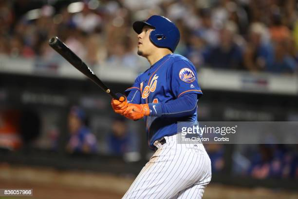 Wilmer Flores of the New York Mets hits a two run home run in the sixth inning during the Miami Marlins Vs New York Mets regular season MLB game at...